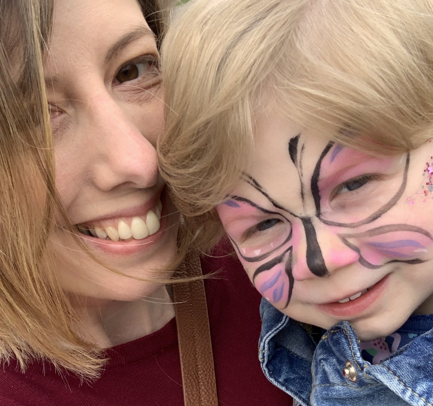 Me with M, with her face painted as a butterfly.