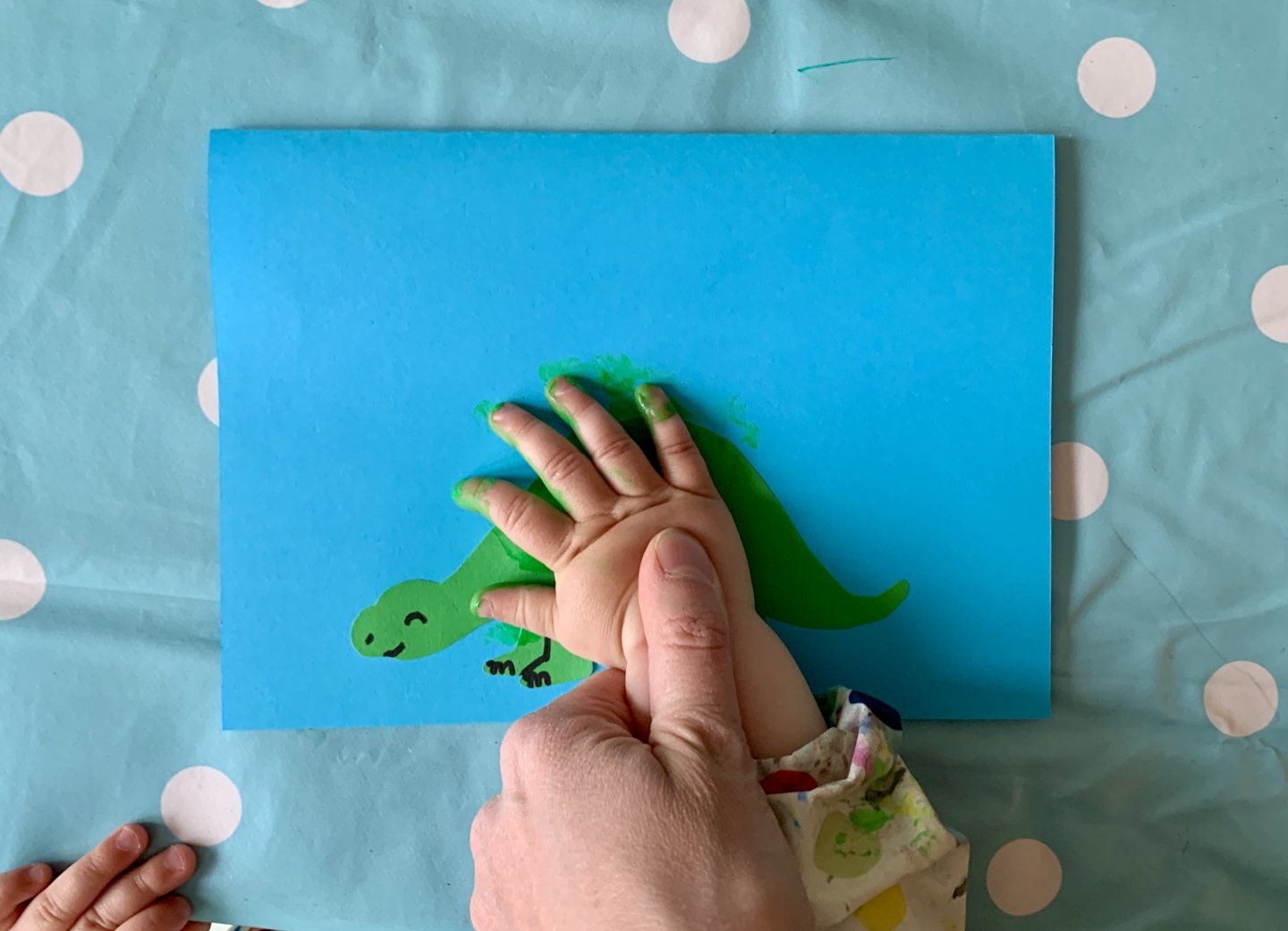 Dinosaur handprint Father's Day card craft